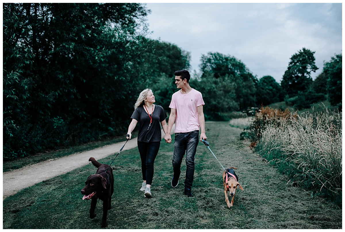 Vicky & Matthew walking the dogs at their pre-wedding session in Holmes Chapel