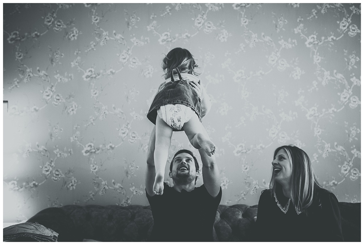 Daddy throwing Florence in the air at their documentary family session
