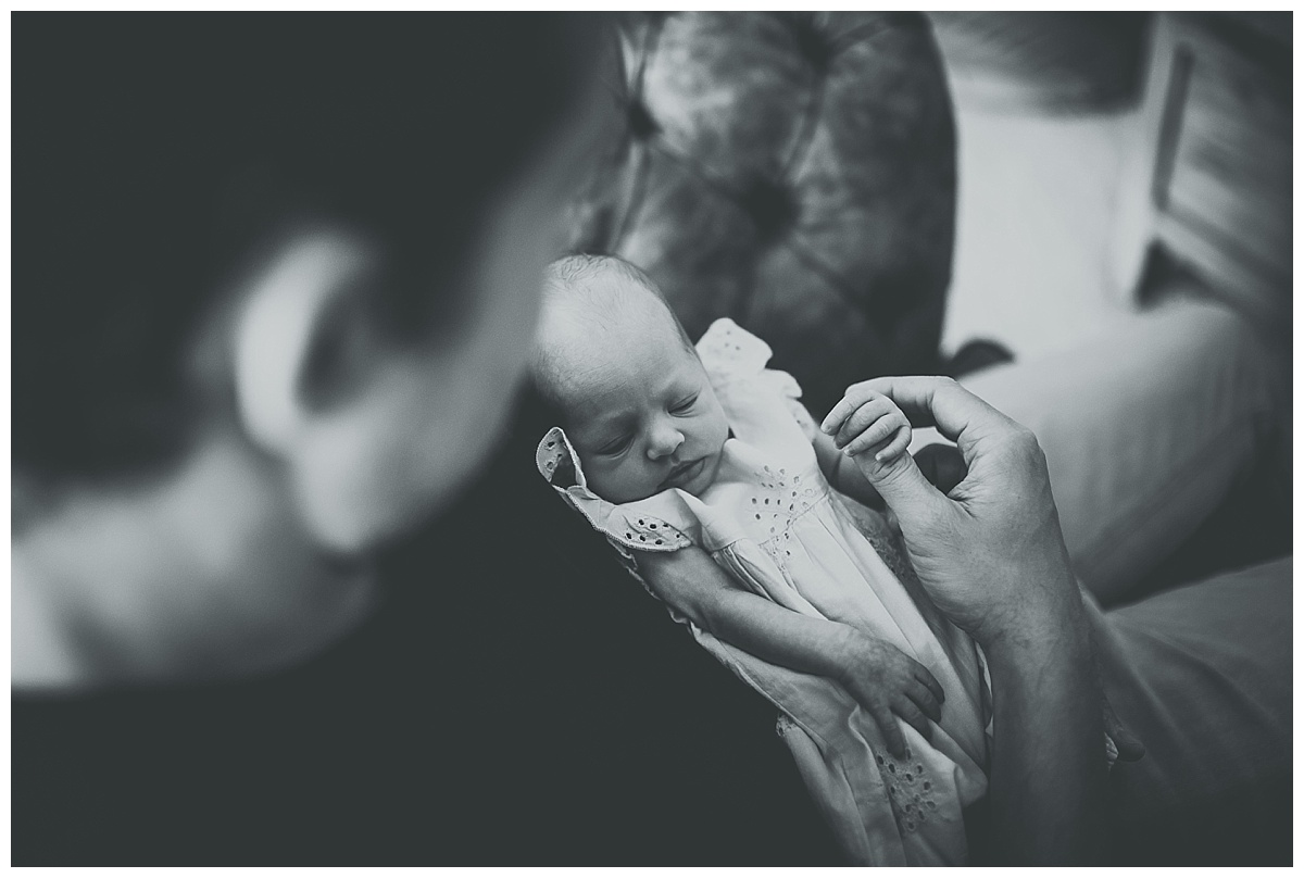 Baby Beatrice in her Daddys arms