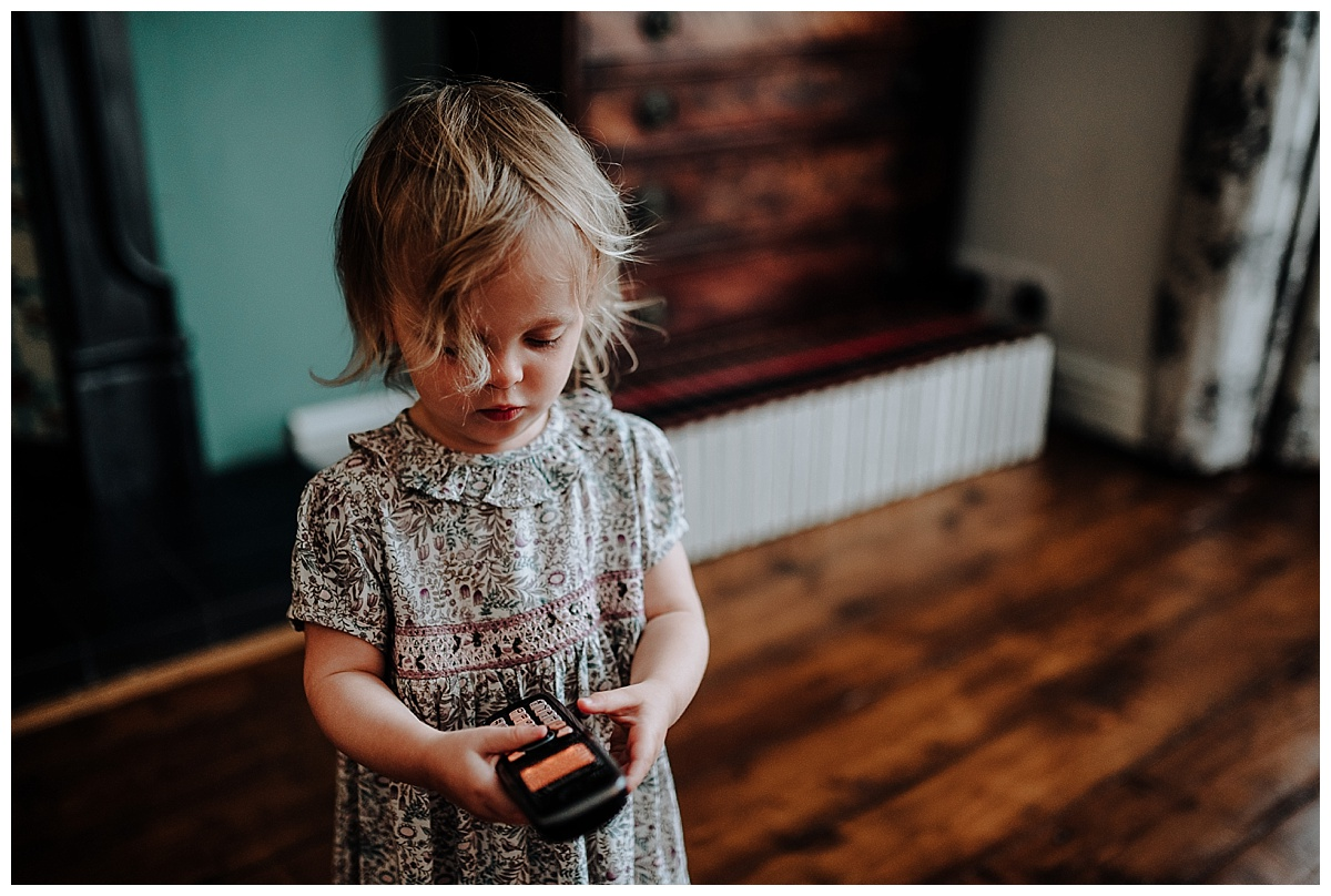 Florence on the phone at her family session