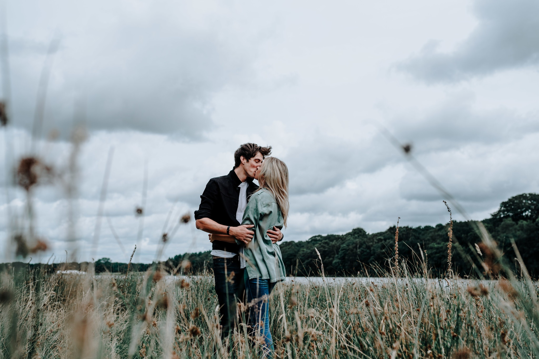 Lauren & Christopher kissing ion front of the lake at Tatton Park, Cheshire