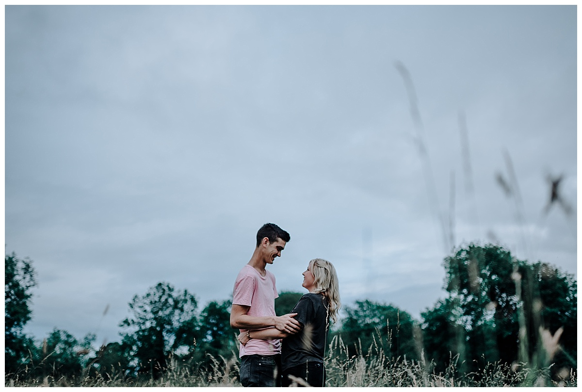 Vicky & Matthew smiling at each other on their pre-wedding session