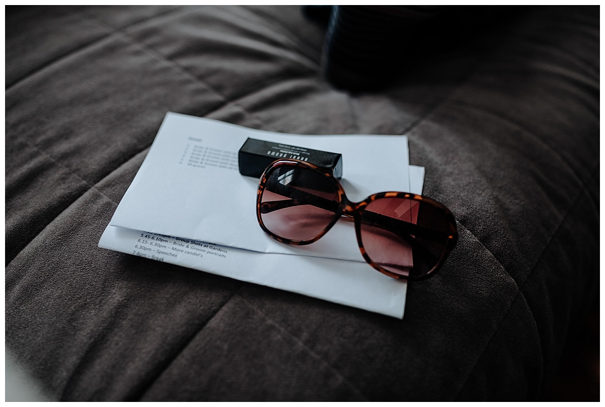 Sunglasses and lipstick on bed at Great John Street Hotel