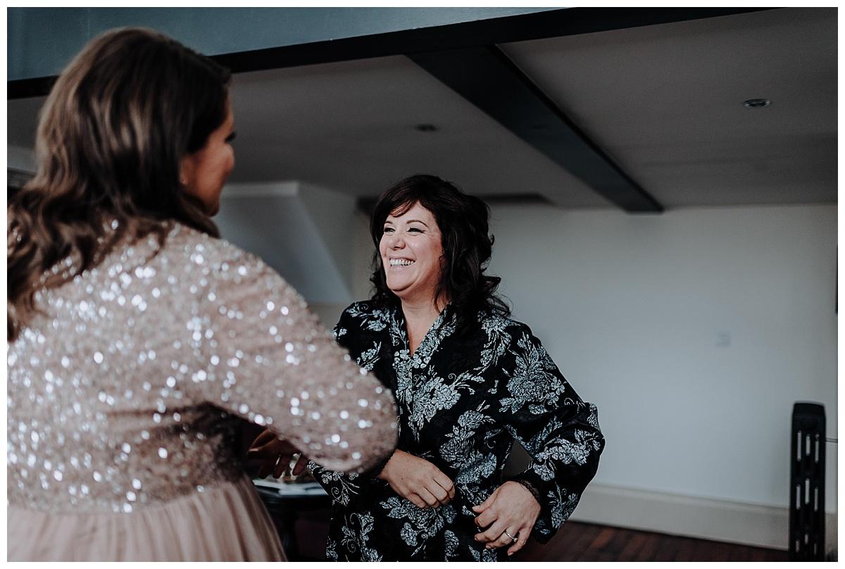 Allison smiling at her Daughter on wedding day morning at Great John Street Hotel