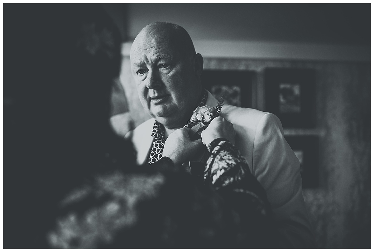 Allison fixing Carls button hole on morning of their wedding at Great John Street Hotel