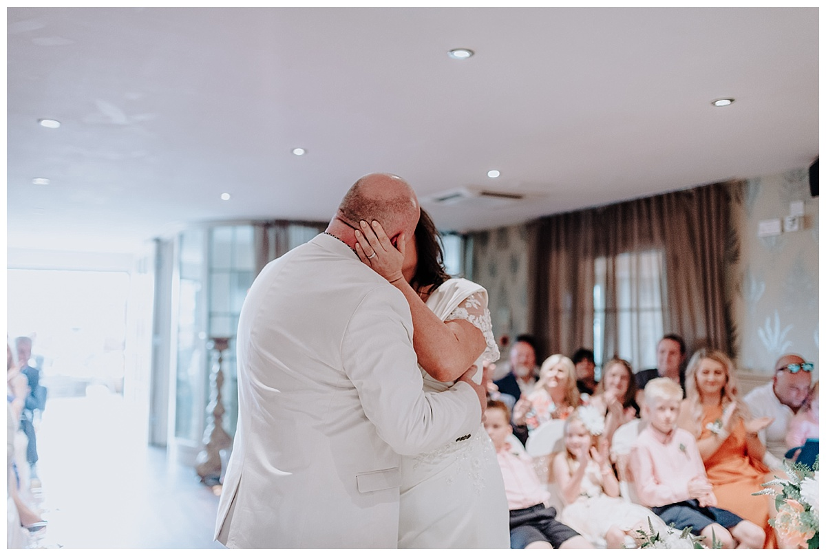 Allison & Carl sharing their first kiss as husband and wife at Great John Street Hotel