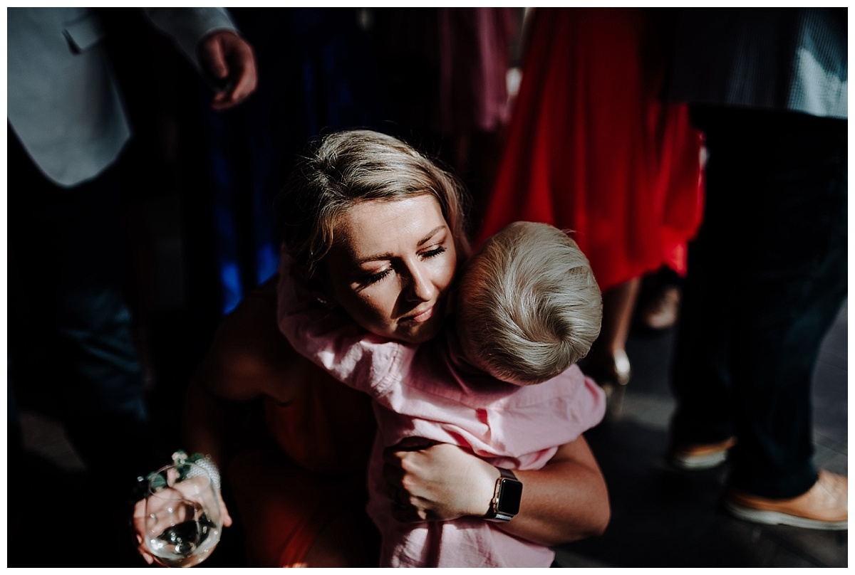 Carl's daughter hugging her son at wedding at Great John Street Hotel in Manchester