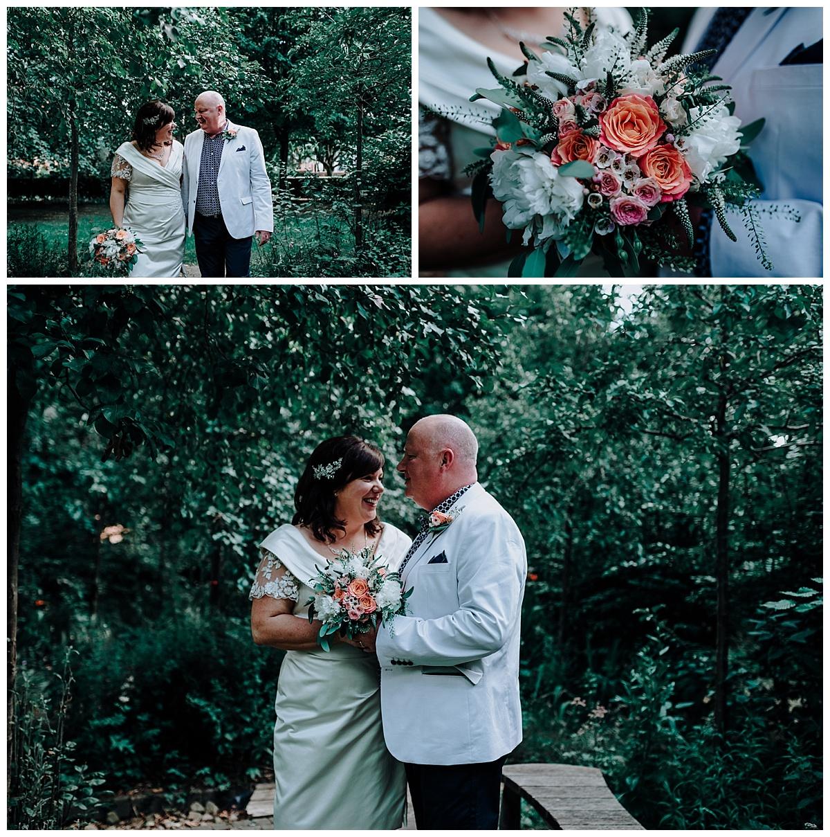 Allison & Carl in gardens in Manchester on wedding day