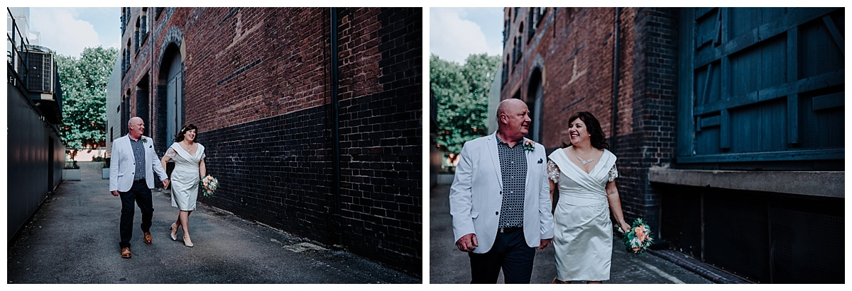 Carl and Allison walking hand in hand in Manchester on wedding day