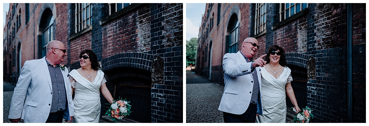 Allison & Carl walking hand in hand with shades on in Manchester on their wedding photography shoot