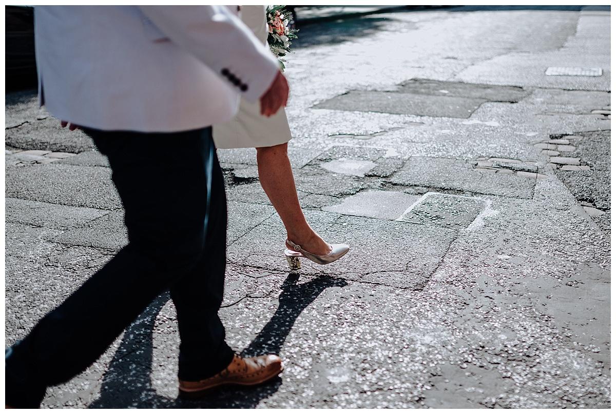 Carl & Allisons legs walking across the street in Manchester