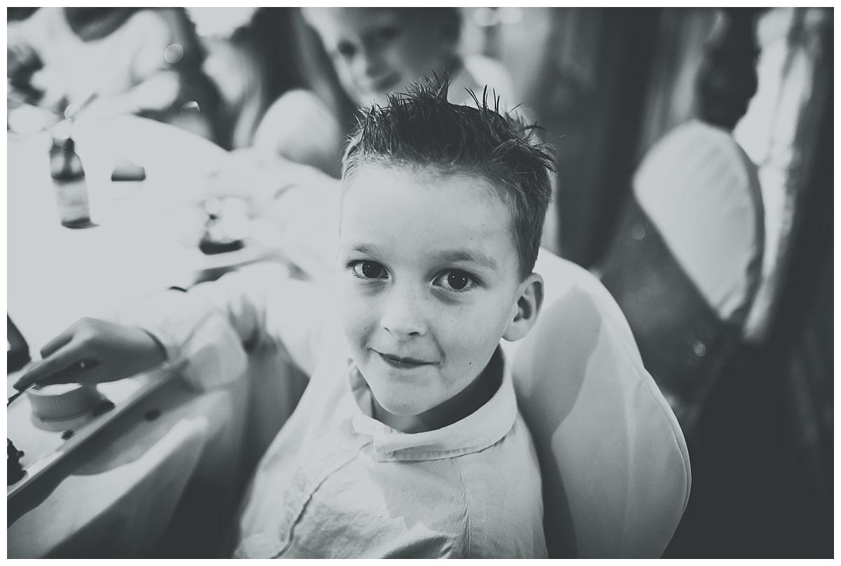 Little boy looking into camera at Great John Street Hotel