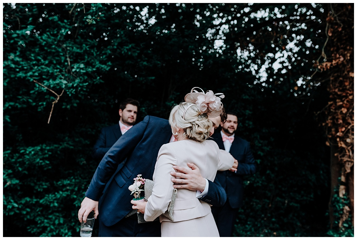 Julie hugging her son on the morning of his wedding