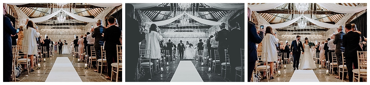Greg and Holly walking down the aisle at Monks Barn in Berkshire