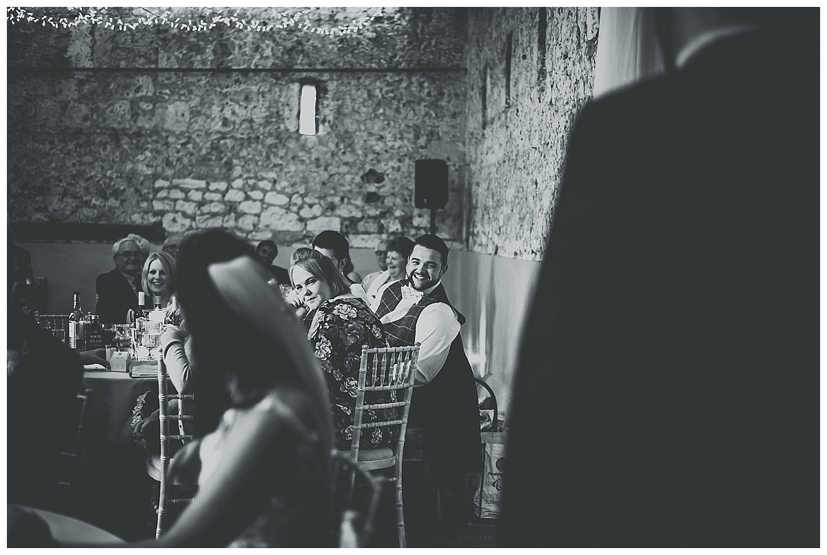 Best man laughing during the speeches at Monks Barn in Berkshire
