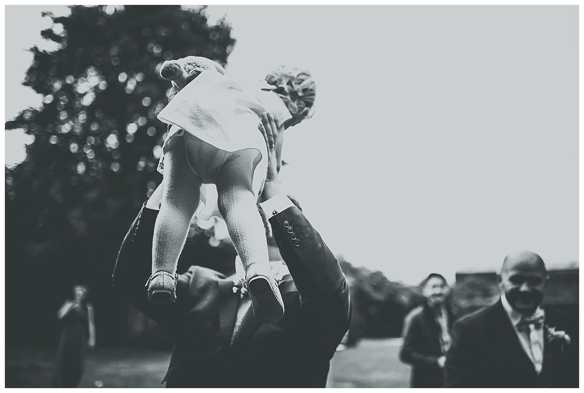 Greg throwing little girl in the air at Monks Barn in Berkshire