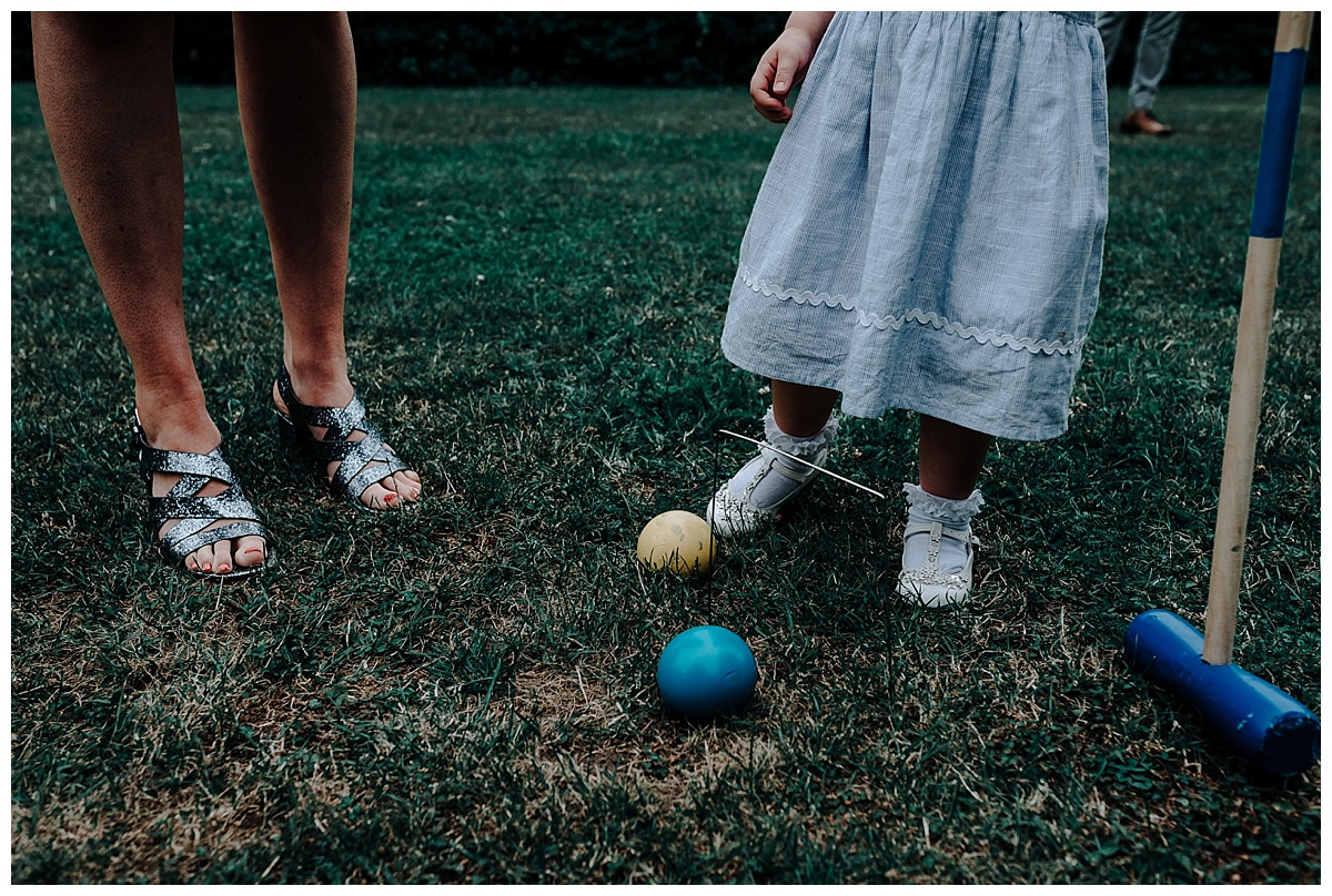 Guests feet by the croquet set at Monks Barn