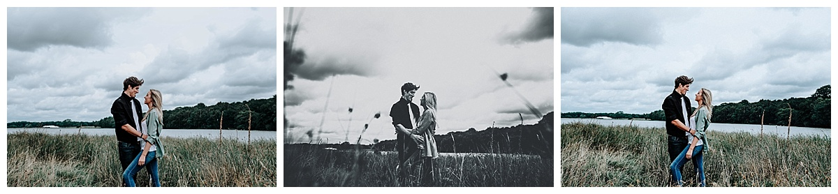 Lauren & Christopher standing in front of the lake at Tatton Park, Cheshire