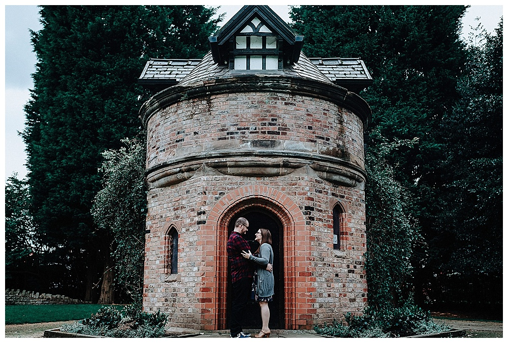 Louise and David stood in front of the tower at Walkden Gardens, Sale
