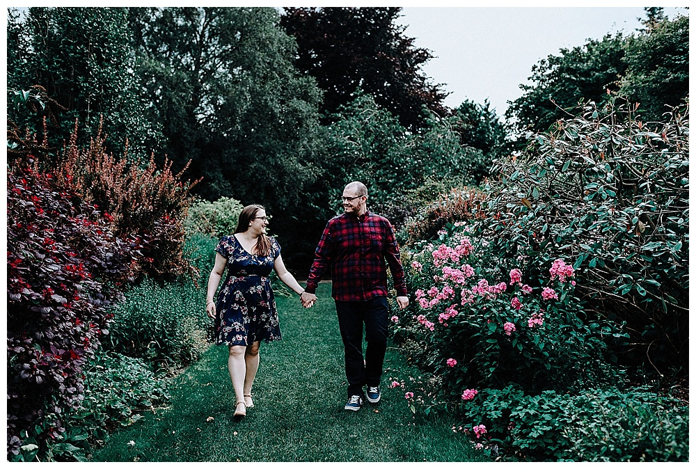 Louise and David walking hand in hand through Walkden Gardens