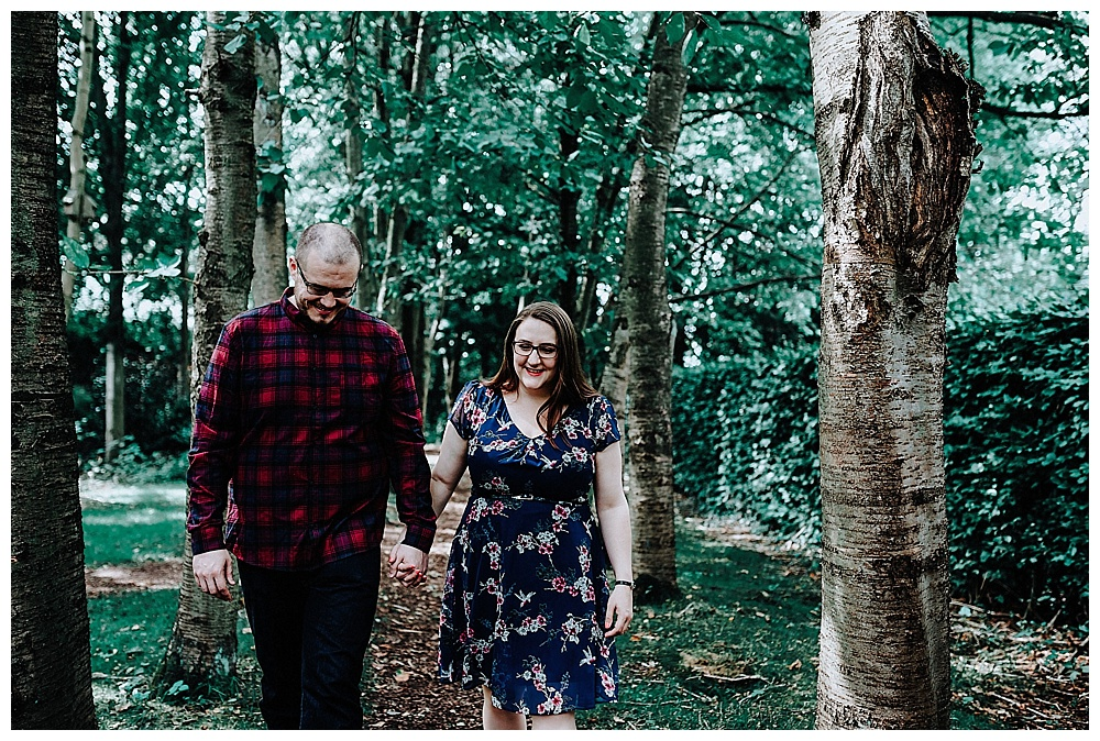 Louise and David walking hand in hand at Walkden Gardens, Sale