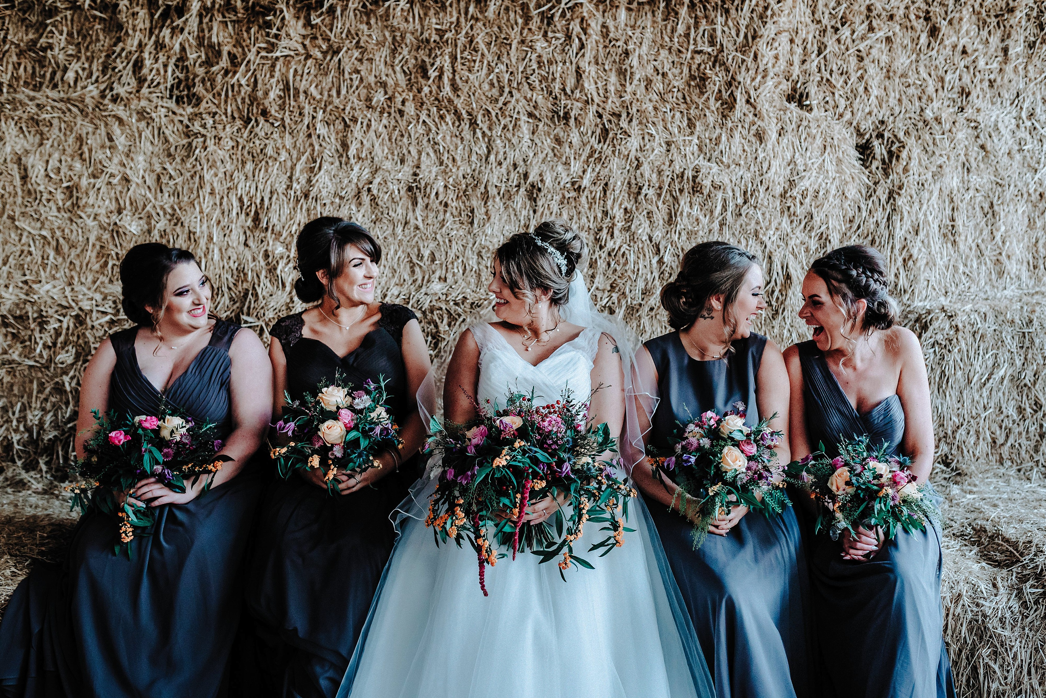 Bride and her Bridesmaids in the barn at a Cheshire Barn Wedding