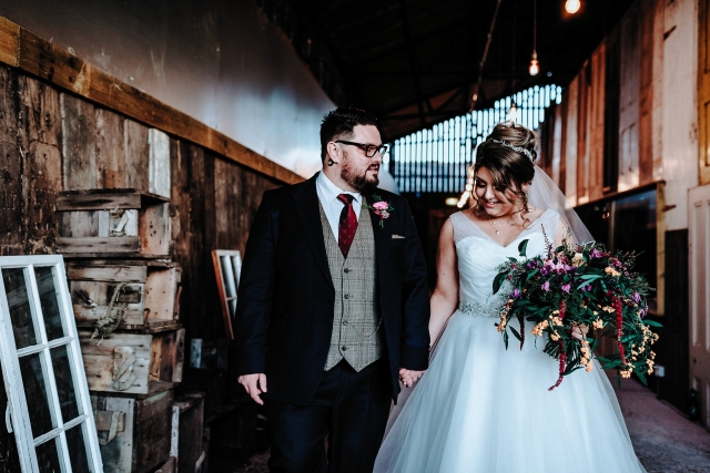 Bride and Groom walking hand in hand at their Cheshire Barn Wedding