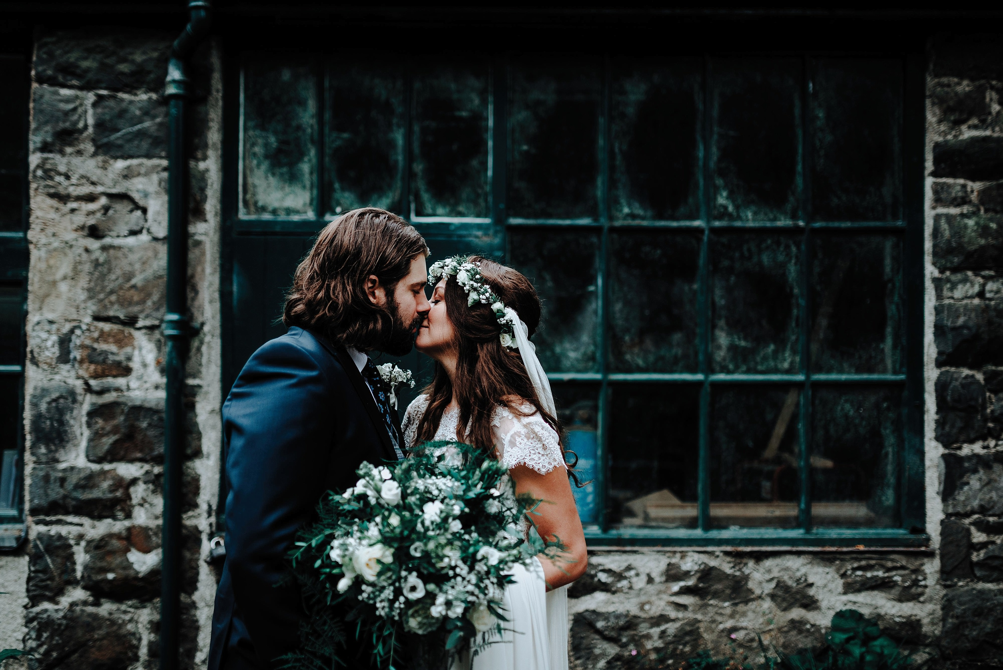 Bride and Groom kissing at their rustic welsh wedding