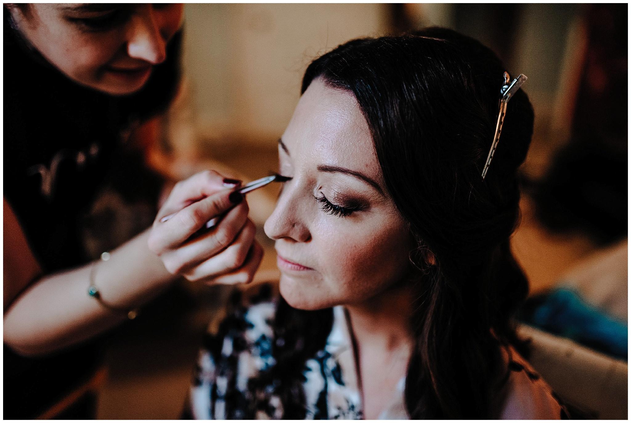 Bride having her makep applied at Bodnant Welsh Food