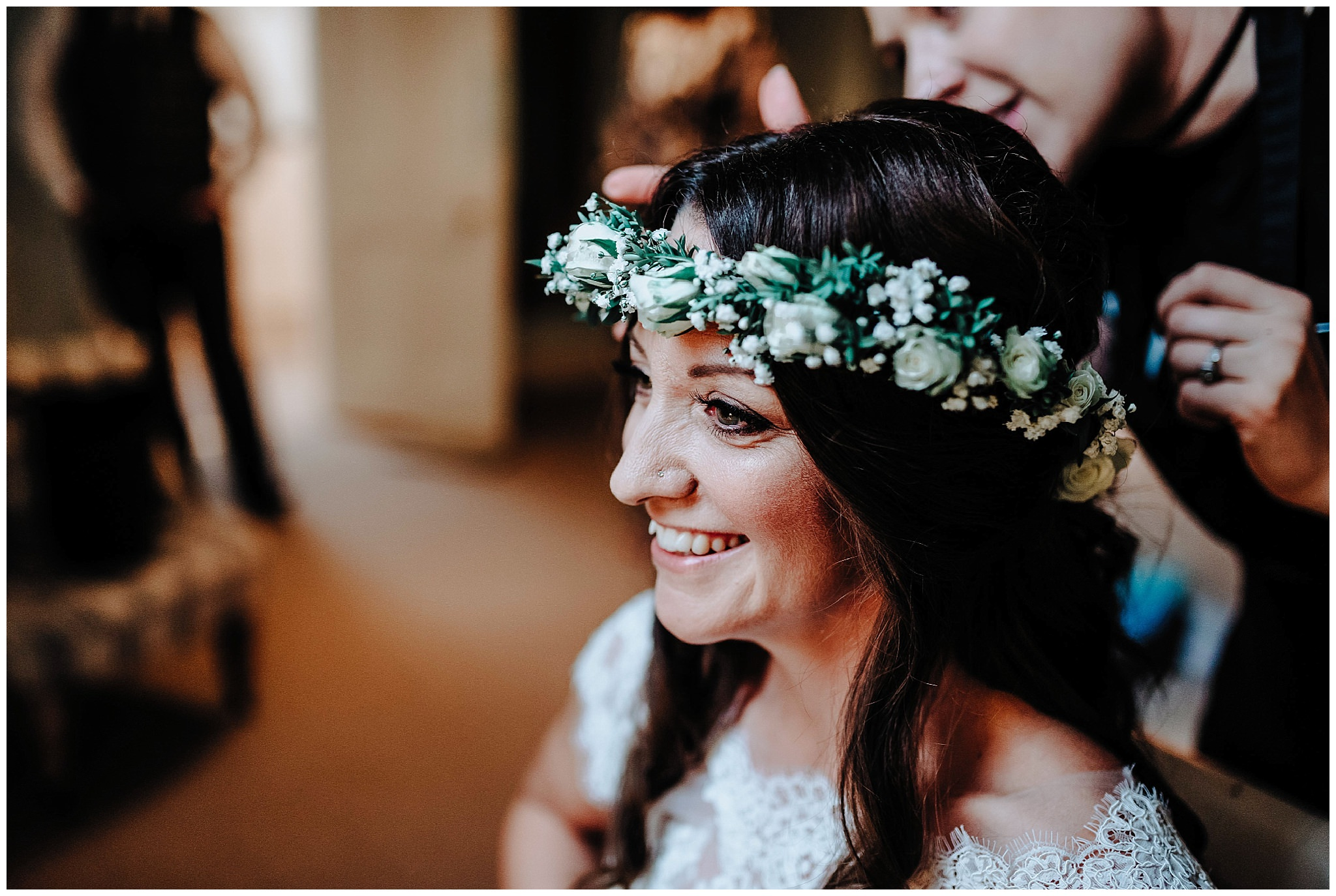 Bride smiling with her flower crown on