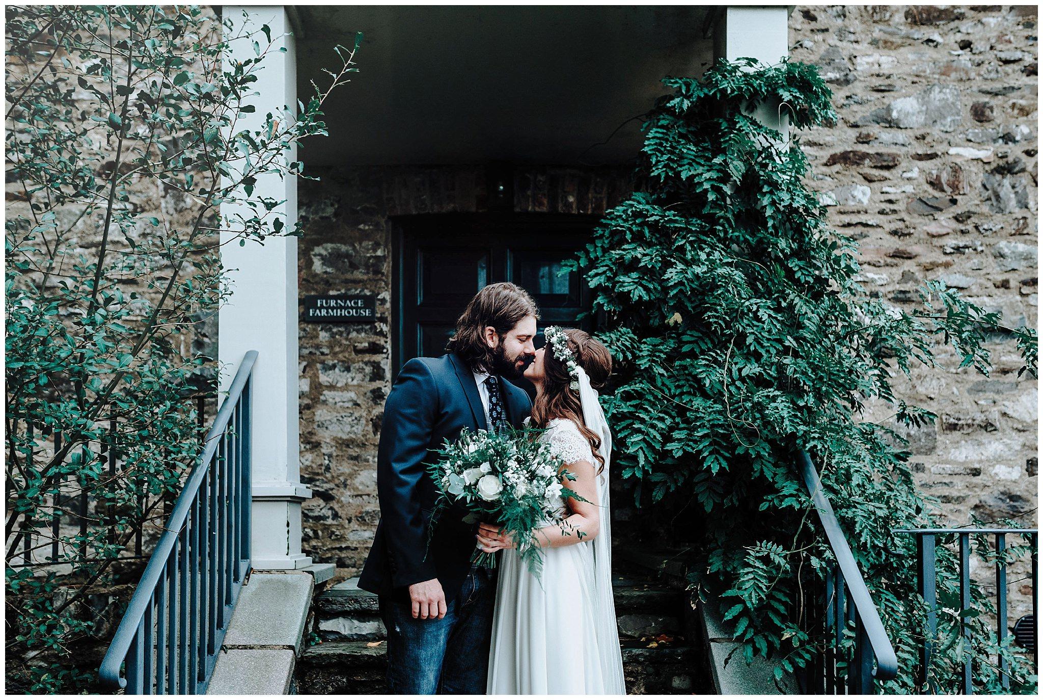 Bride and Groom in front of steps at Bodnant Welsh Food
