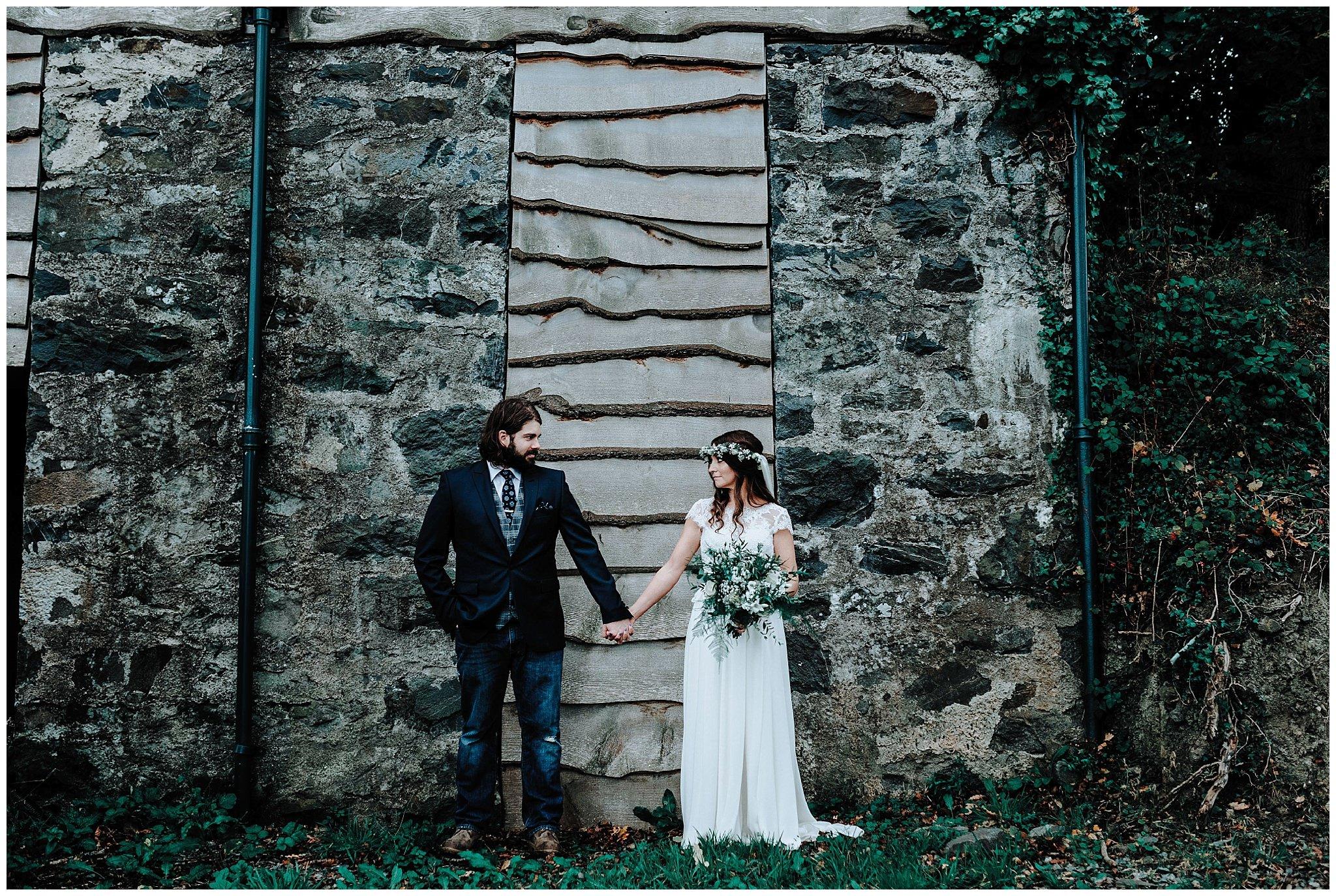 Bride and Groom holding hands at Bodnant Welsh Food Centre
