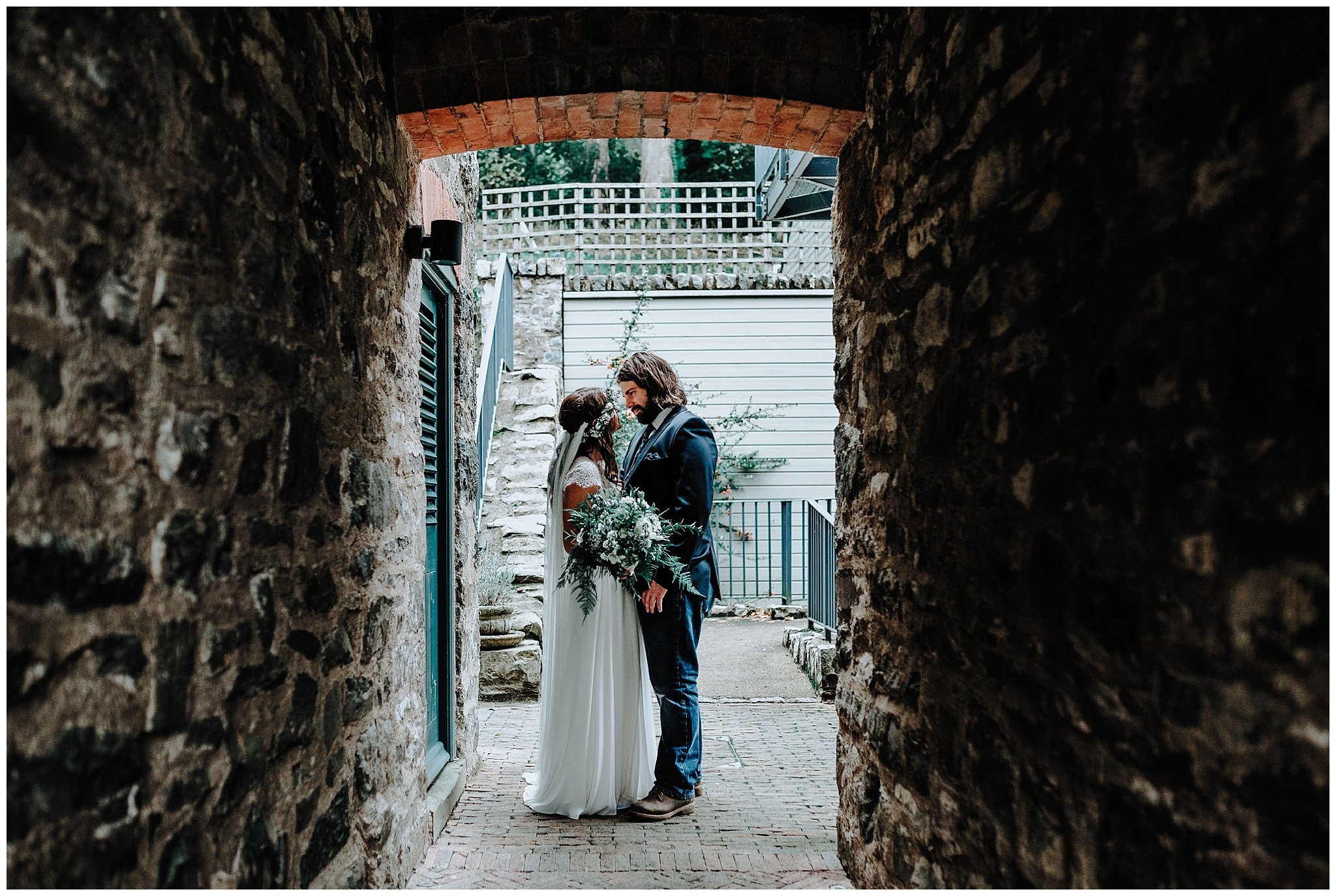 Bride and Groom in tunnel at Bodnant Welsh Food Centre