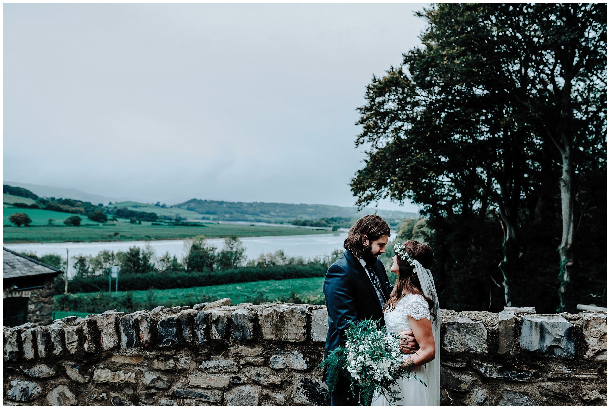 Bride and Groom looking out at the view at Bodnant Welsh Food Centre