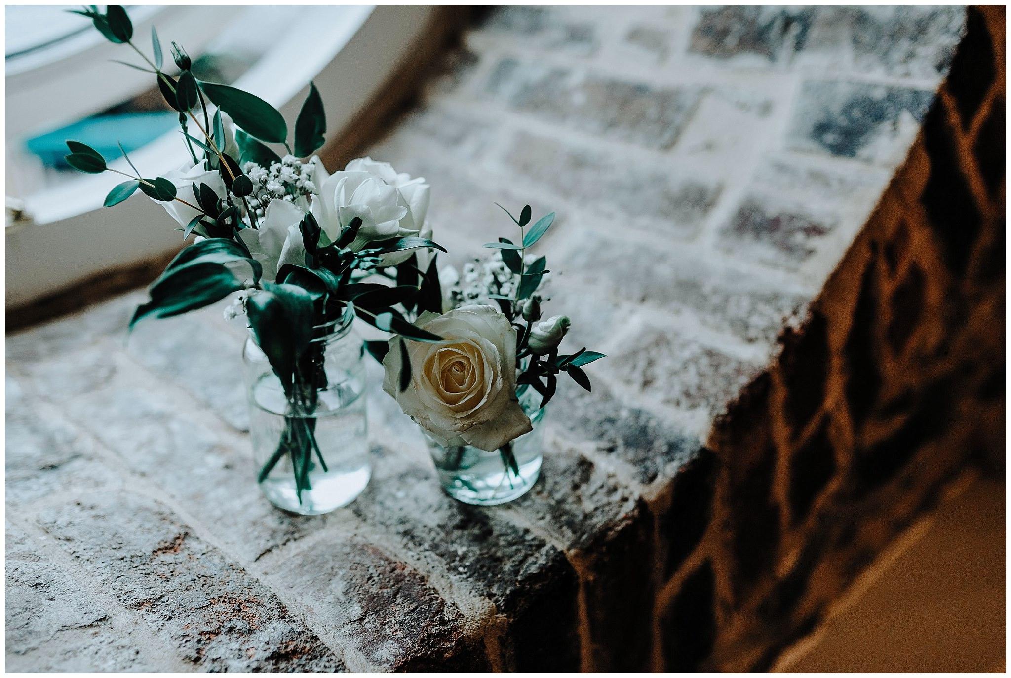 White roses in vases at Bodnant Welsh Food Centre