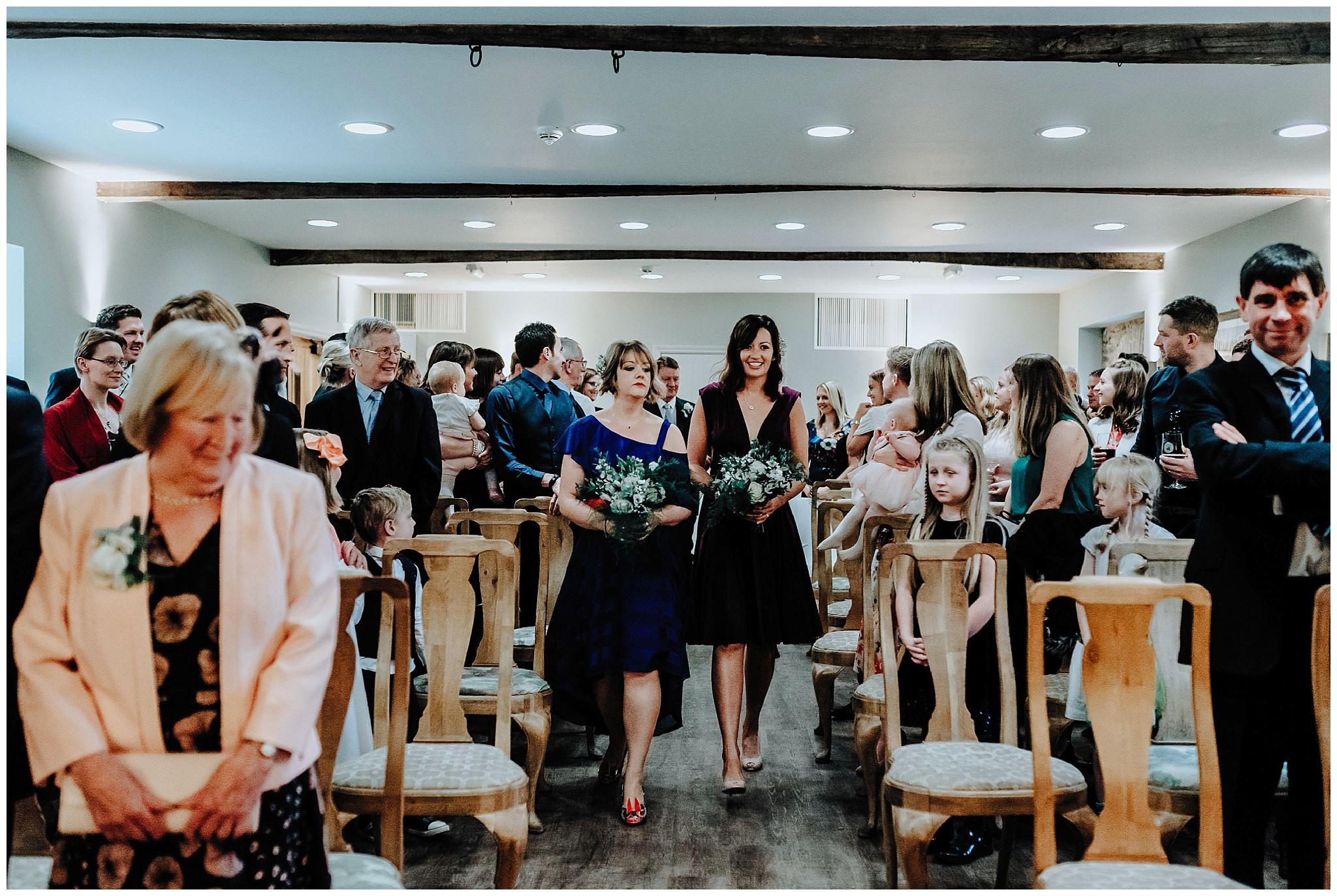 Bridesmaids walking down the aisle at Bodnant Welsh Food Centre