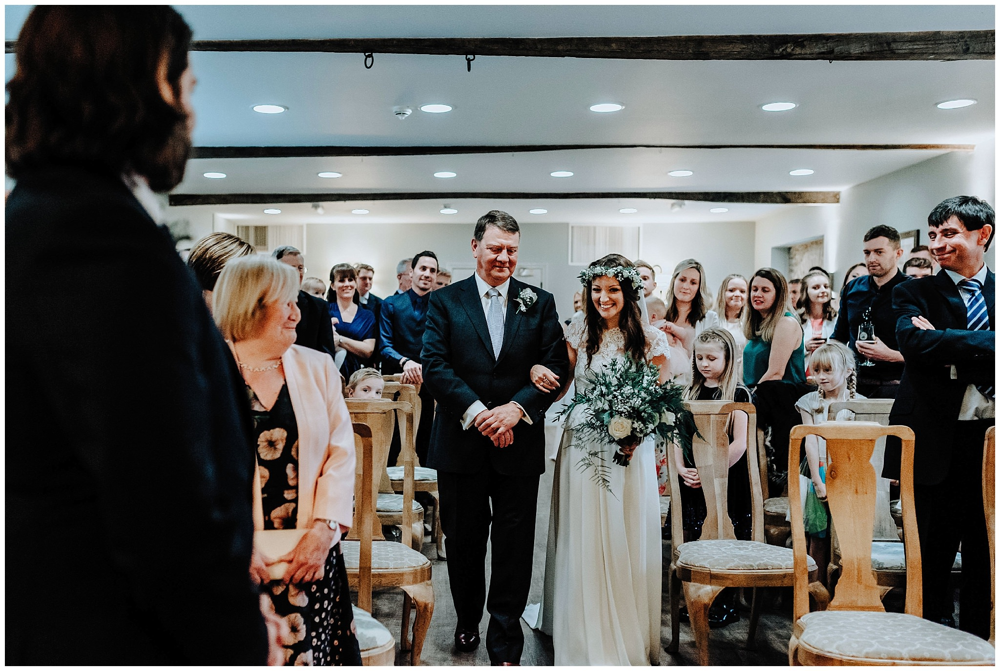 Bride and Father walking down the aisle at Bodnant Welsh Food Centre