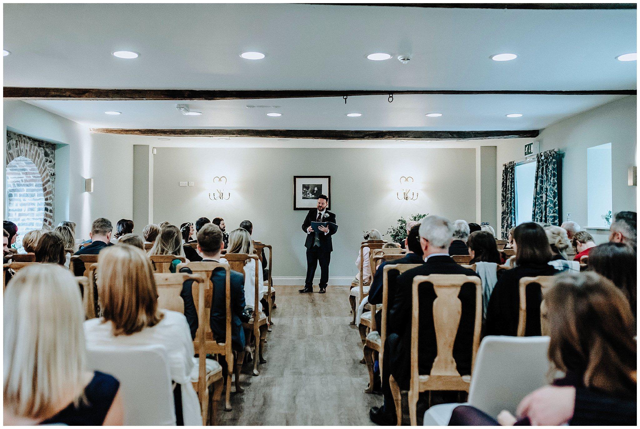 Brides Cousin being the celebrant at wedding at Bodnant Welsh Food Centre