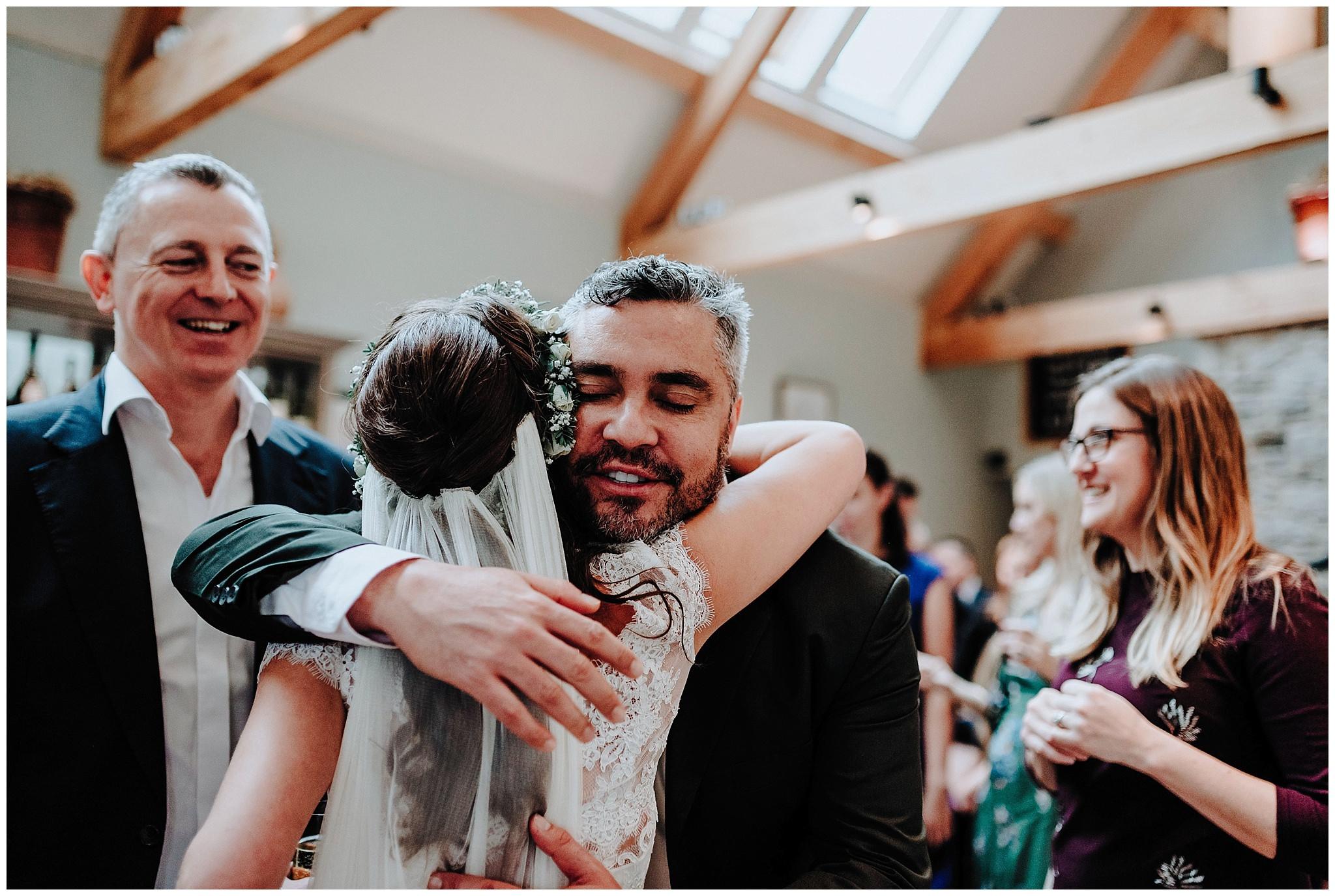 Guest hugging the Bride