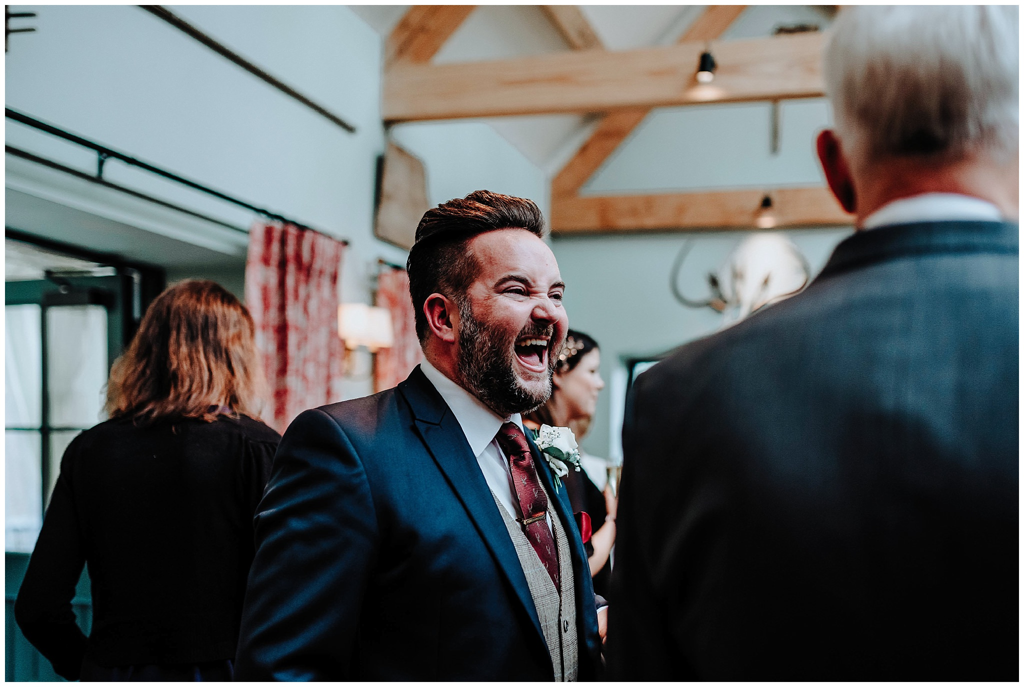 Guest laughing at wedding at Bodnant Welsh Food Centre