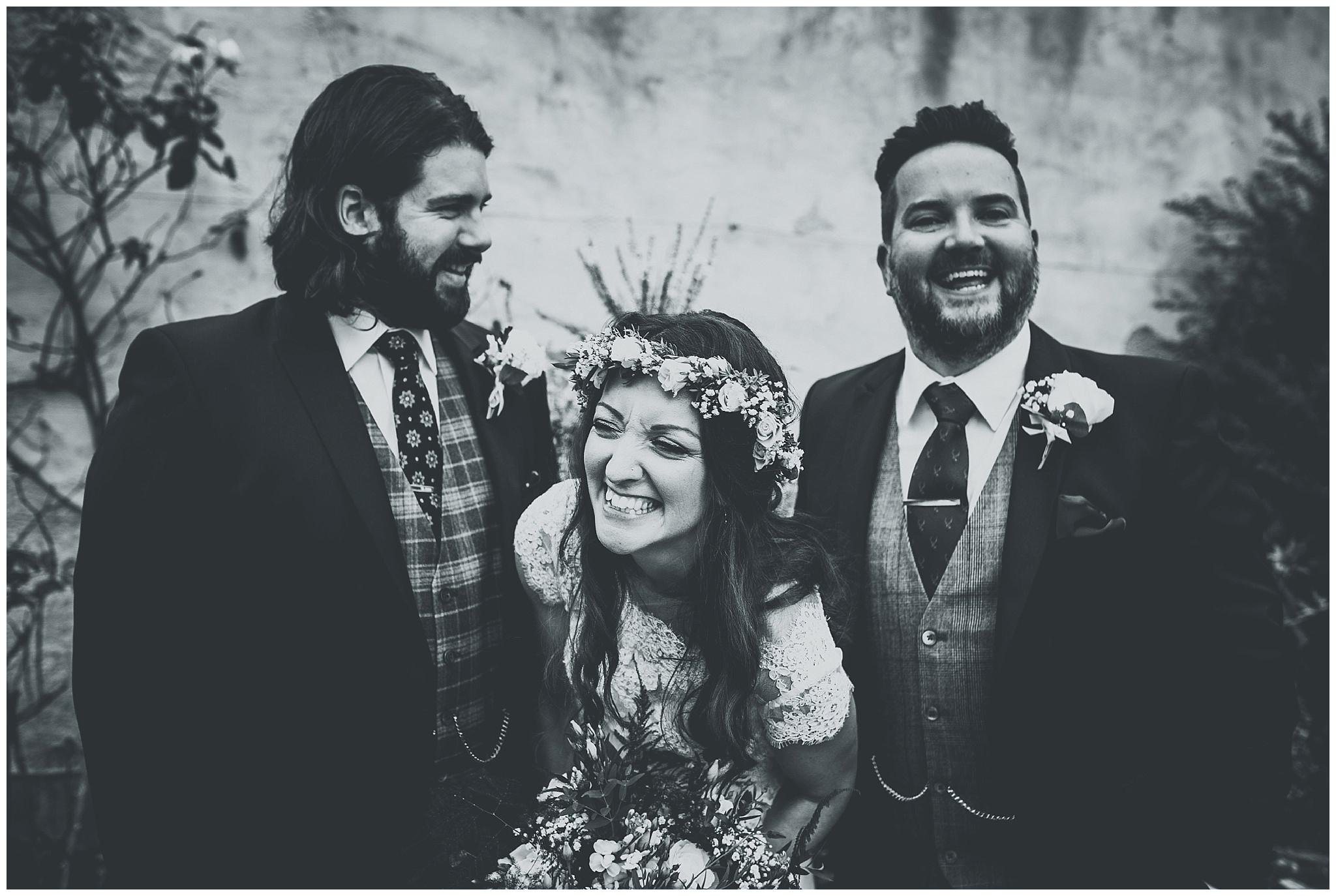 Bride laughing at Bodnant Welsh Food Centre