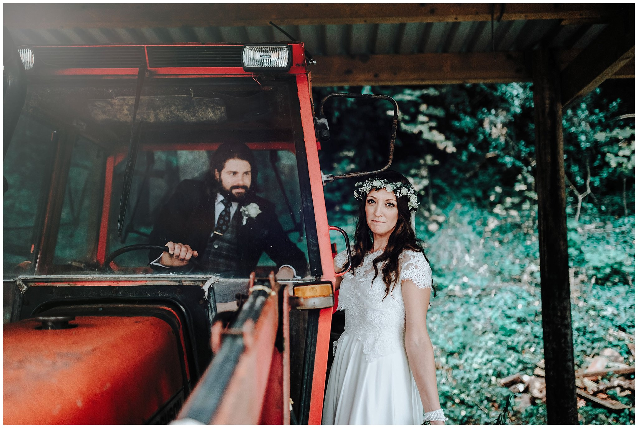 Bride and Groom on red tractor at Bodnant Welsh Food Centre