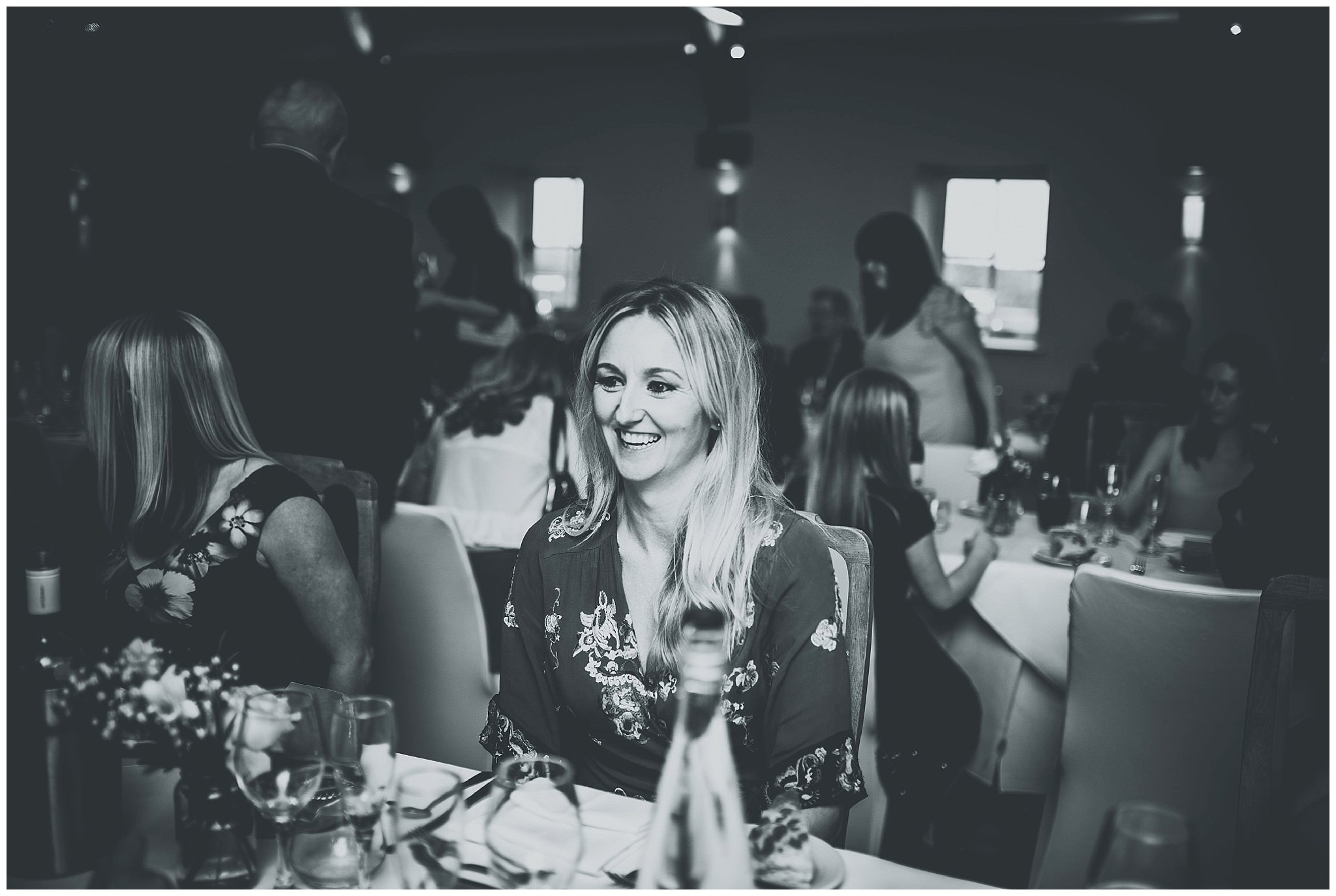 Guest laughing during wedding meal