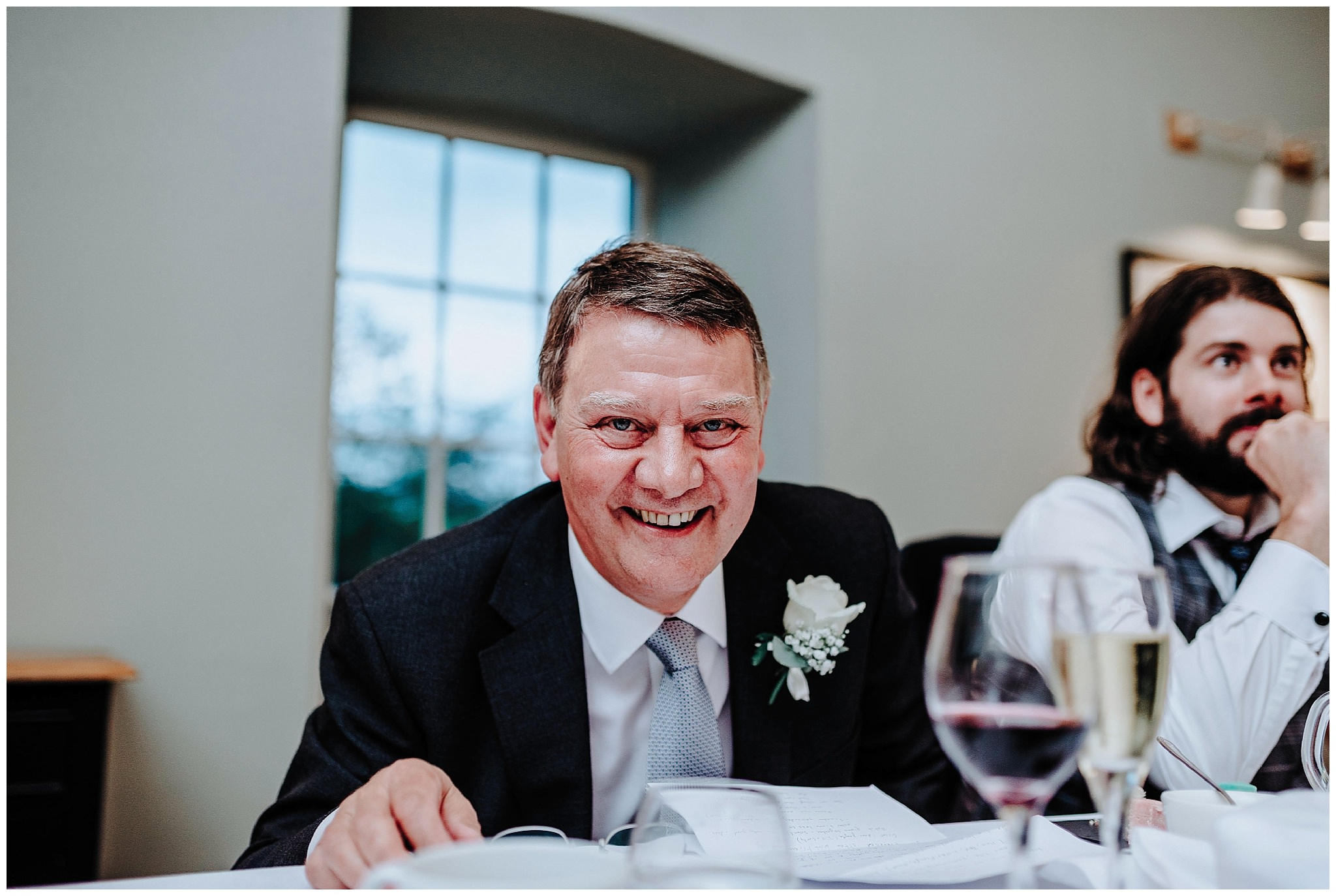 Father of the bride smiling during his speech