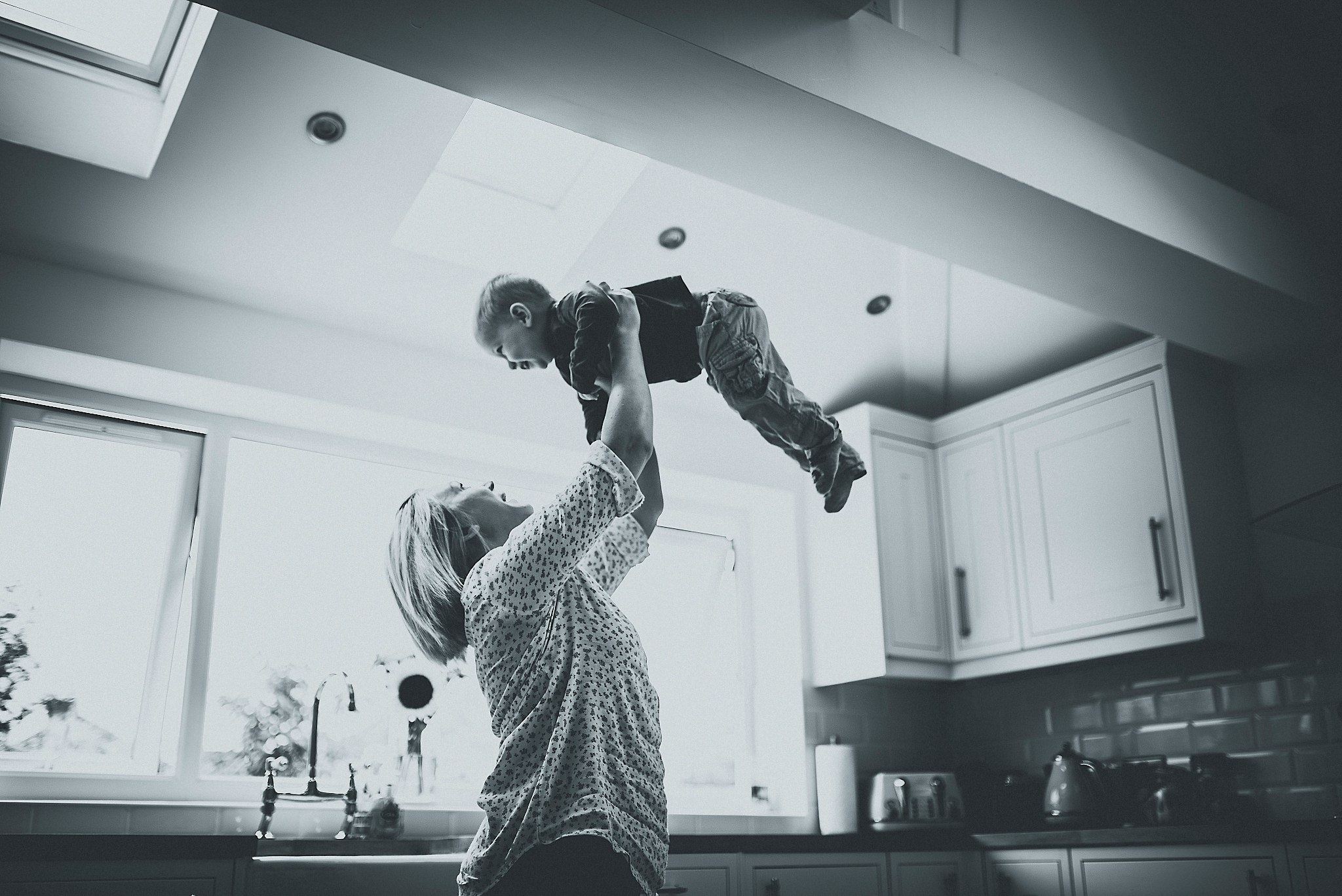 Mum lifting son up at a Cheshire Lifestyle Family Photography Session