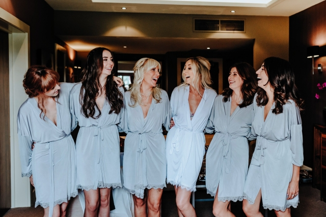 Bride and Bridesmaids smiling at bridal prep at a Cheshire Barn Wedding