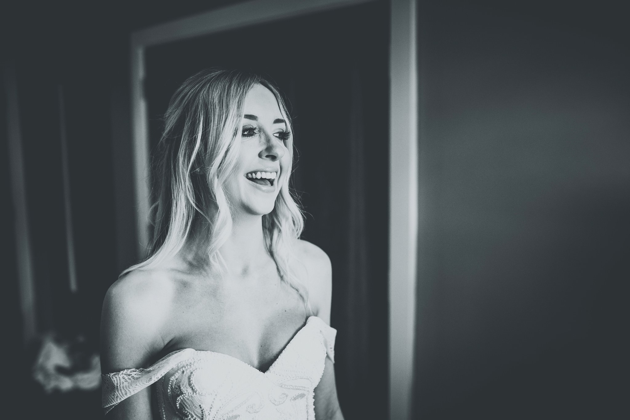 Bride smiling on the morning of her cheshire barn wedding