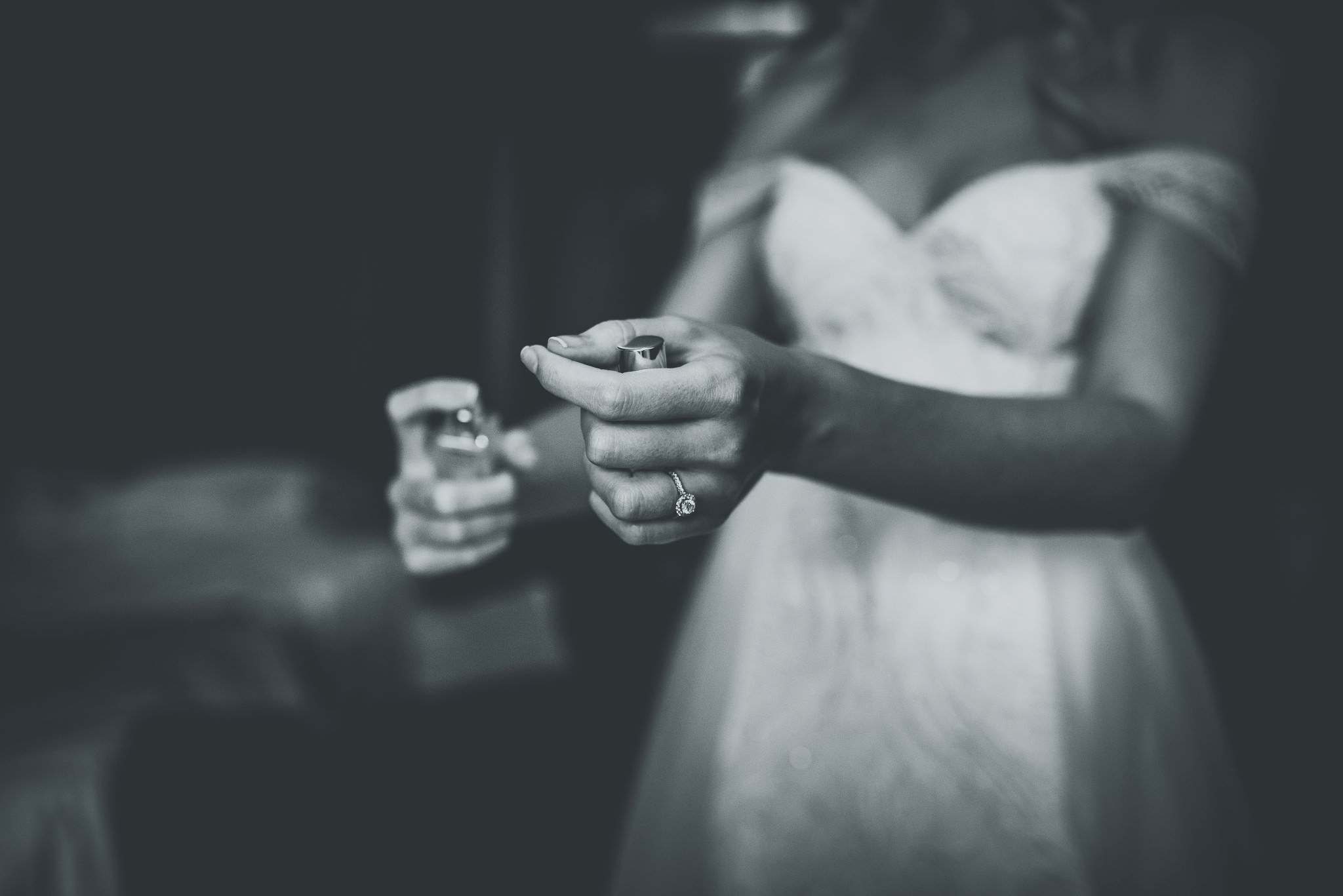 Bride putting her perfume on for her Cheshire Barn Wedding