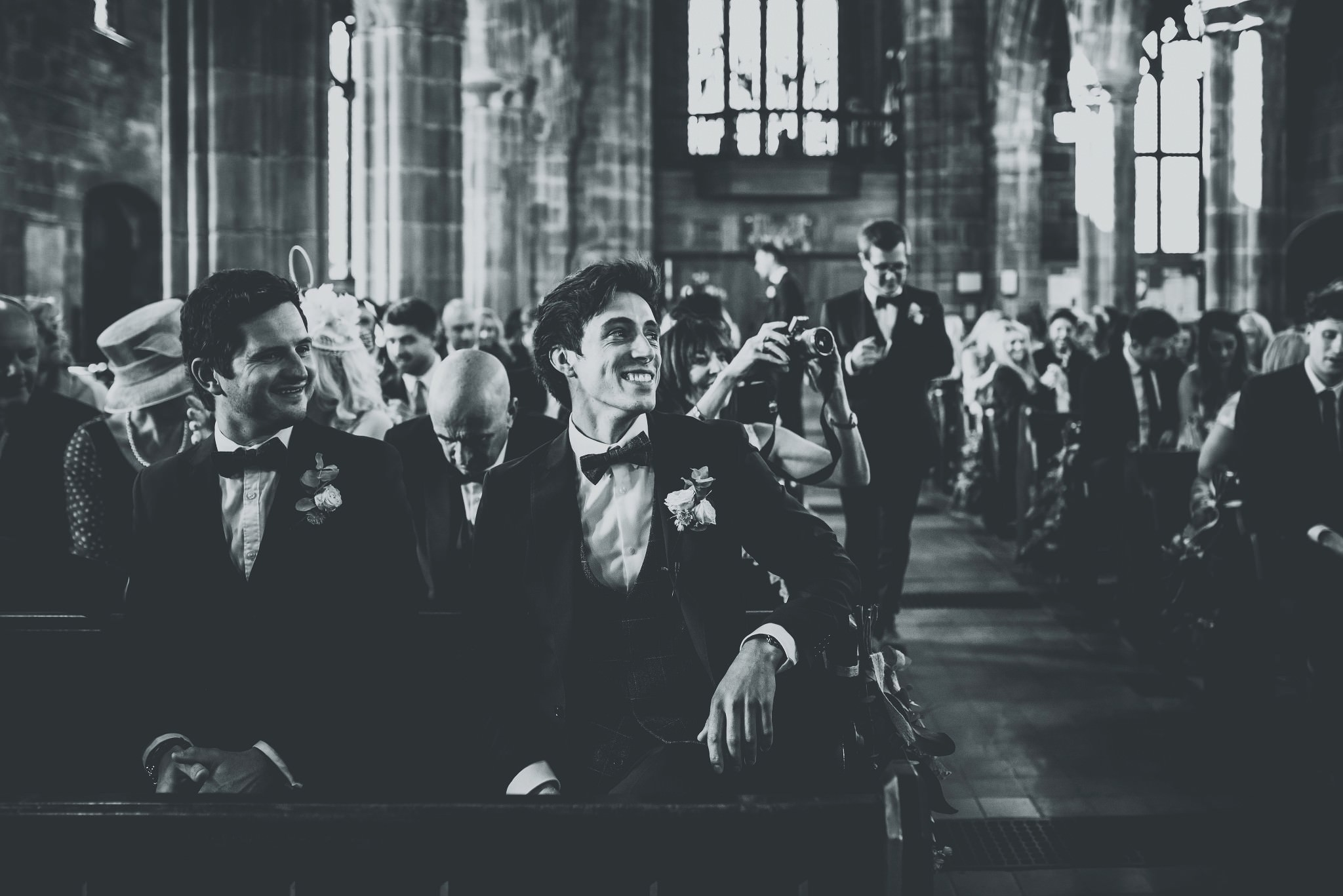 Groom smiling in the church in Cheshire