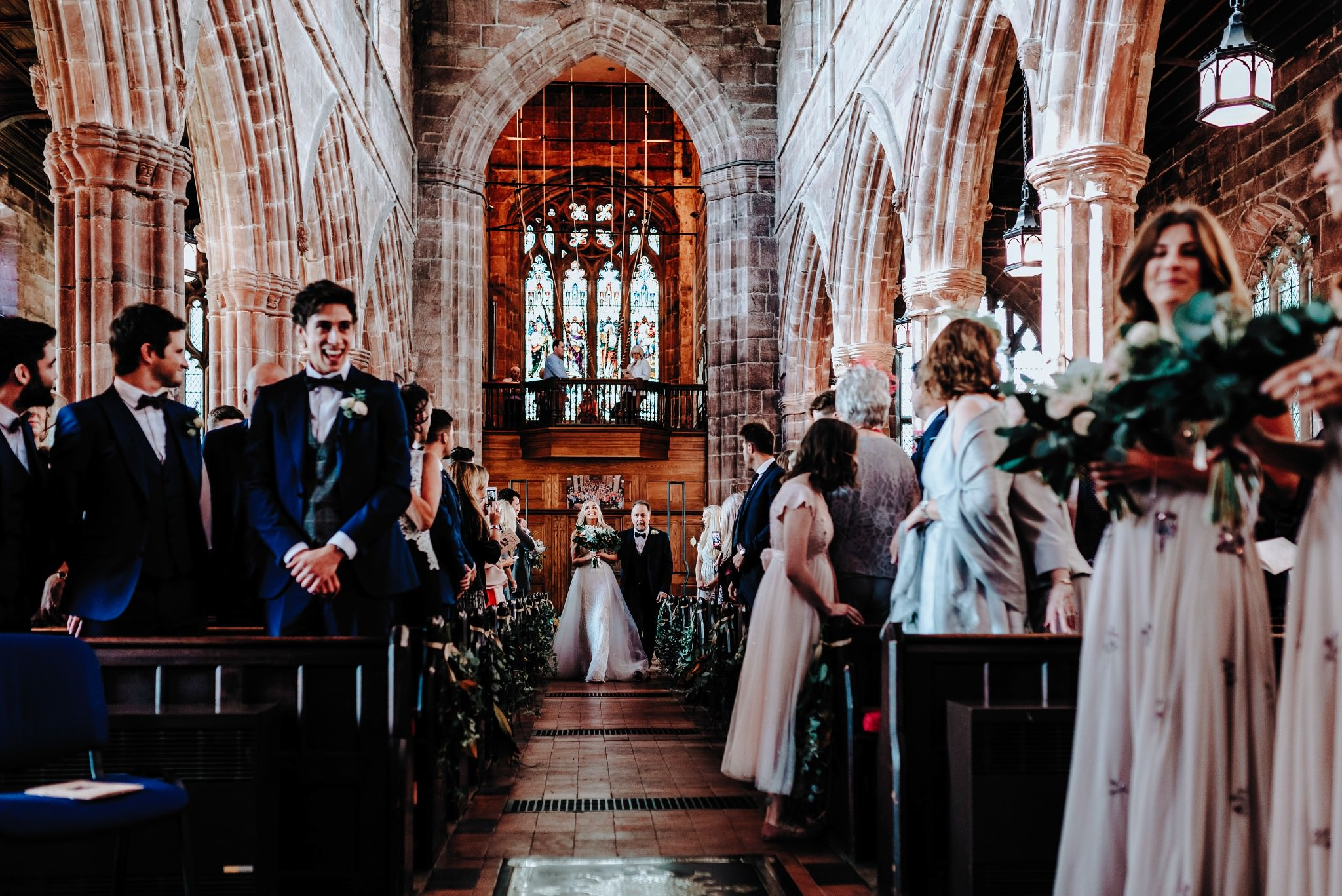 Bride and Father walking down the aisle at Great Budworth Church in Cheshire
